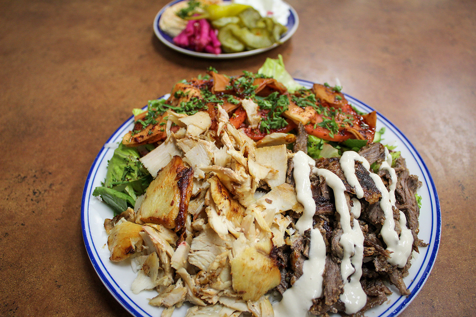 Photo of chicken and beef shawarma plate from Shawarma Palace