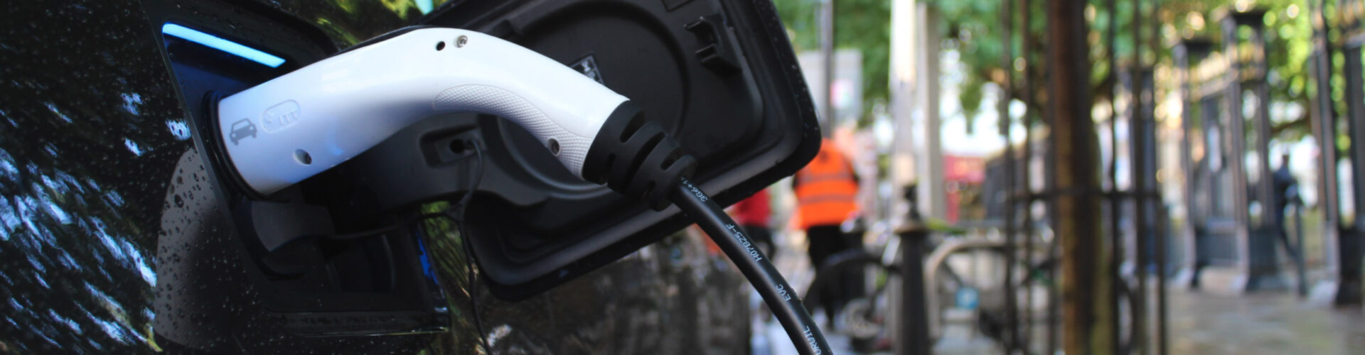 Close-up of electric car charging
