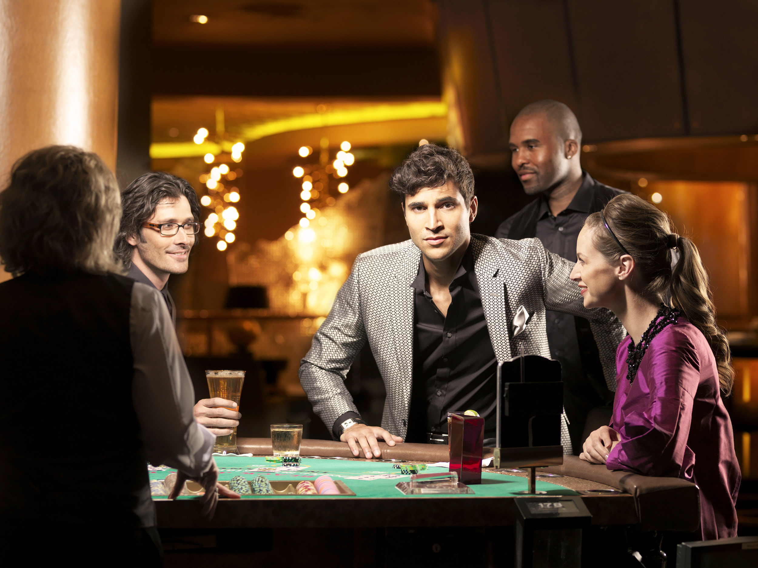 Couple seated at a black jack table