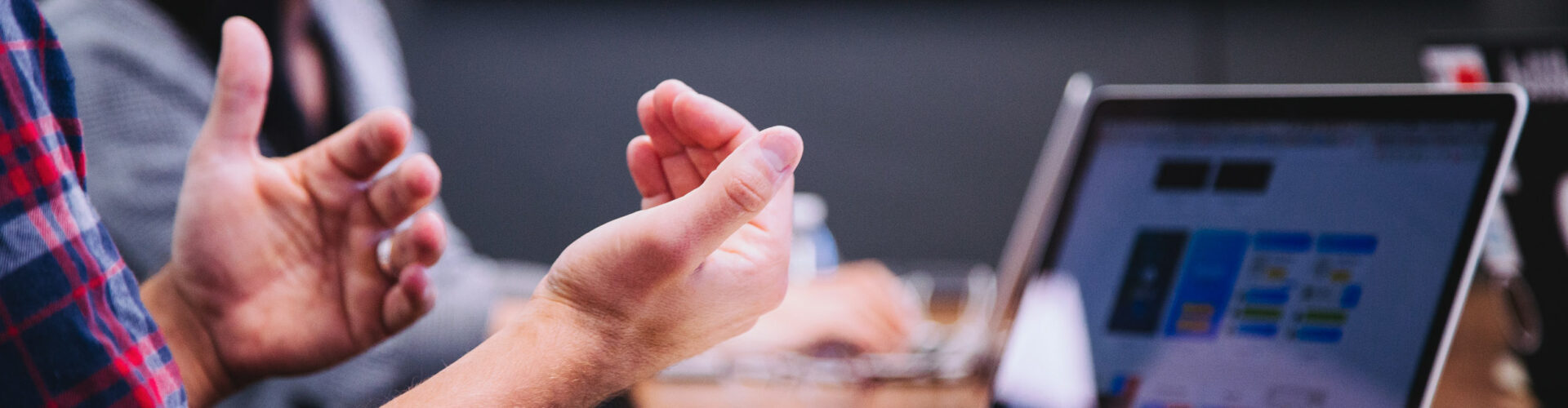 Close up of man gesturing while sitting at a boardroom table