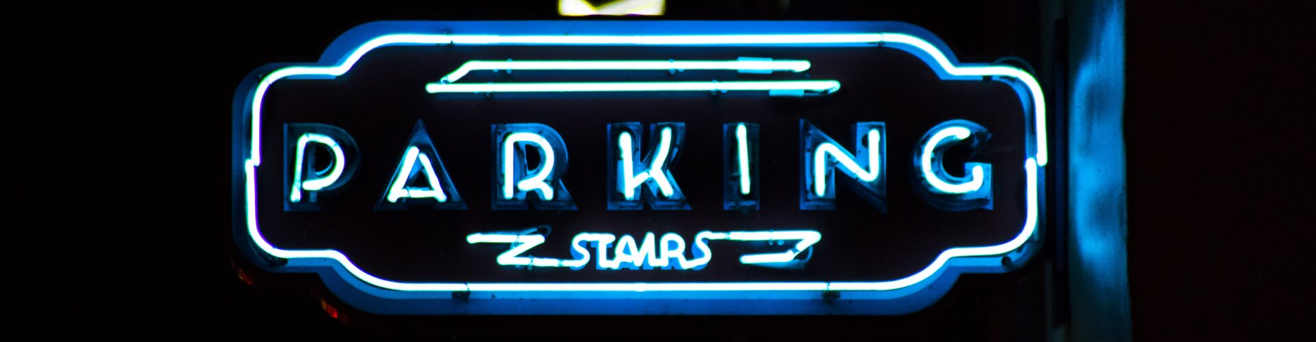Blue neon sign spelling the word